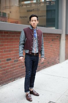 Mens fashion, New York Street Style. Mens Preppy style. Varsity jacket, blue knit tie, rolled jeans, brown double monk strap shoes. Asian men.   www.angelspov.com