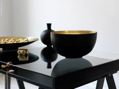 Black and gold Asian bowls and table