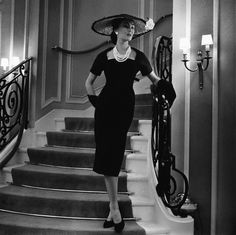 https://flic.kr/p/8B92o3 | March 1956 | Dior's house model, Alla wears a navy wool dress, with a square neckline, accompanied with a wide-brimmed straw hat and gloves.   Image by Hulton-Deutsch Collection/CORBIS