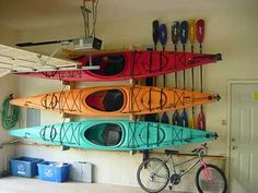 Not only do I want a fleet of kayaks but I want a whole wall in my garage to store them! :) too bad hubby's crap is in the way! I'll have to settle for hanging the from the garage rafters likely Garage Shed, Garage House, Garage Workshop, Garage Room, Garage Workbench, Kayak Storage Rack, Kayak Rack, Kayak Garage Storage, Kayak Hanger