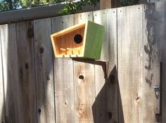 This mid century modern birdhouse was designed and built by Douglas Barnhard owner of Sourgrass located in Santa Cruz California. This birdhouse