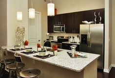 Modern Kitchen with High ceiling, Breakfast bar, 25.54 cu. ft. Side by Side Refrigerator in Stainless Steel, Flush, U-shaped
