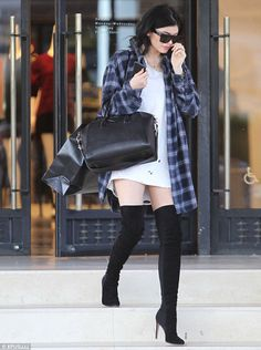 Sky's the limit: Kylie was spotted in stiletto over-the-knee boots as she shopped at Barneys New York