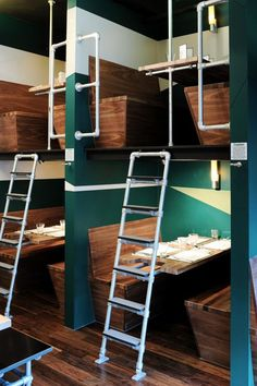 interior restaurant with chairs and floors of wood with an iron ladder
