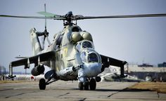 The Russian Mil Mi-24 large helicopter gunship and attack helicopter. The machine holds the world record of helicopter speed at 368,4 km/h
