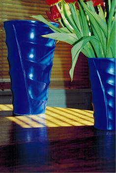 Madagascar vases in an electric bright blue
