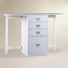 White Folding Craft Desk   World Market - This is a great option for a desk that we wouldn't use all the time in our small apartment...except it only comes in white.