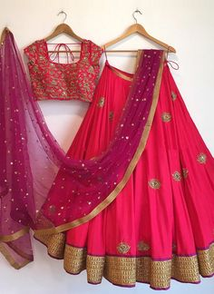Shop magenta with gleeful resham & zari work designer lehenga choli online.This set is features a magenta blouse in silk fully embellished with crystal, embroidery and sequin work.It has matching magenta lehenga in silk with beautiful embroidery all o Indian Lehenga, Half Saree Lehenga, Lehnga Dress, Lehenga Choli Online, Pink Lehenga, Lehenga Blouse, Lehenga Choli Designs, Half Saree Designs, Blouse Designs