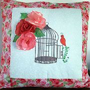 Embroider an exotic Birdcage Cushion with beautiful 3D roses in peach and bronze organza from Enchanting Designs.