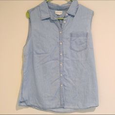 Light Blue Lucy&Laurel Sleeveless ButtonDown Light blue sleeveless button down. All buttons in place. Single pocket on front. Pre-owned. Worn 2 or 3 times. Lucy & Laurel Tops Button Down Shirts