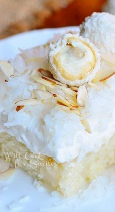Rafaello Poke Cake: Coconut Cake with White Chocolate/Coconut Cream & Whipped Topping