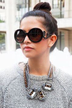 Click to shop chic shades by Prada and other high-end designers.