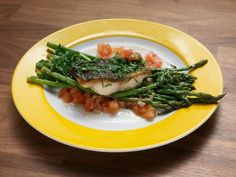Sea Bass with Asparagus Recipe | Alex Guarnaschelli | Food Network Seafood Dinner, Fish And Seafood, Worst Cooks, Beefsteak Tomato, Sea Bass, Asparagus Recipe, Beef Steak, Fresh Herbs, Food Network Recipes