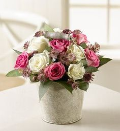 roses, astrantia and eucalyptus