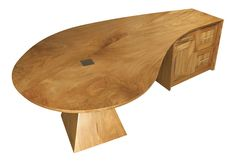 Lagoon Marri Office Desk $24,400.00 This piece was inspired by the Lagoon with a small inlet which is seen in many areas of the Abrolhos Islands. The marri was chosen for it's natural curve and for the swirled grain offering a feeling of tidal movement. The pyramid support has angular connections to the rock overhangs and with it's stainless steel inlay it offers a window to beauty hidden below. Materials:Marri with Stainless steel. Can be ordered in Jarrah timber. Size: 280