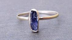 Love this Benitoite ring! Benitoite is the official state gem of California, and it's one of the rarest gemstones in the world. This rough cut ring shows off the lovely color of the stone.
