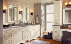 Shown to the right, this combination vanity dressing table creates the perfect pampering space right in your bathroom.  By KraftMaid Cabinets, available at JustCabinets.com