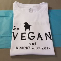 """Preparing one of our women's slim-fit """"Go Vegan and Nobody Gets Hurt"""" tshirts for delivery! We personally delivered it to her doorstep, she put it on straight away and loved it! :)"""