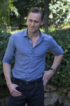 Tom Hiddleston, torturing his shirt buttons. Not that I'm complaining.