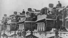 Tiger I tanks on the move, notice the use of the combat tracks, rather than the narrower transport tracks, indicating that during their travel the railway didn't go through a tunnel or narrow bridge, allowing immediate combat use once they arrived at their destination. Doing this was actually forbidden, but time and again logistics personnel would overlook the rules whenever possible, as fitting the transport tracks meant removing the fours roads wheels visible on each tank per side.