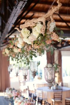 Hanging branches covered in flowers and lanterns, swoon! #reception | Photography: Sarah Kate - sarahkatephoto.com Read More: http://www.stylemepretty.com/2014/05/06/urban-english-garden-inspired-wedding/