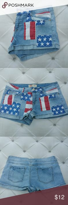 """Flag Patchwork Denim Cuffed Shorts Sz 15 LEI brand Ashley Lowrise style denim cuffed shorts . Patchwork flag red white and blue embellishing all over front. Excellent condition. Tagged size 15 Regular . Fits size 12/14 womens as well.  Measurements : Length 10"""" 2 1/2"""" inseam 16"""" across front waist laying flat  #ravenkittystyle #4thofjuly #denim #cuffed #redwhiteblue #flag #flagshorts #jrs #womens #casual #beach #lake #holiday #size15 lei Shorts Jean Shorts"""