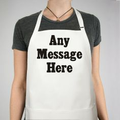 """Any Message Personalized BBQ Aprons. Baking in the kitchen will be so much better with your new Personalized Apron. The Standard Message Personalized Apron is a white full length, 65/35 cotton/poly twill fabric apron with adjustable neck and matching fabric ties. Machine washable. This custom bib apron measures 28"""" x 30"""" and features 3 center pockets for convenient storage. The Standard Message Personalized Apron comes personalized with any three line message in our"""
