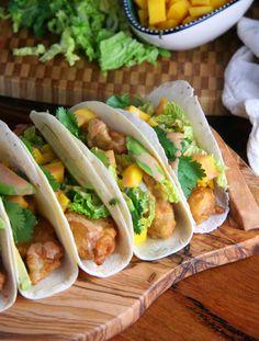 Beer battered fish tacos with mango, avocado and sriracha-hoisin drizzle