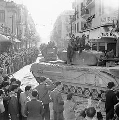 May 8,1943: A British Army Churchill tank and other vehicles parade through Tunis #tanks #worldwar2