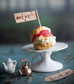 Scones mean tea time, and our little versions have a wonderful pink rhubarb compote tucked inside. This is afternoon tea at its most decadent.