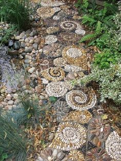 A pebble mosaic will give your yard, garden, or walkway a unique and unexpected focal point.  More detail here