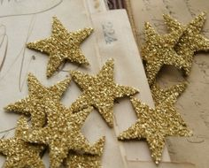 glittery stars are hanging on my Christmas tree