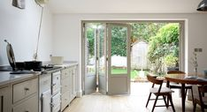 ? Bi-fold doors with wooden panel at bottom ? More tradional look ? In keeping with shaker kitchen