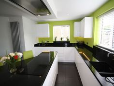 Bold colours in this #handleless kitchen designed and installed by @kitchencraftnet