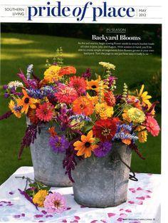 Southern Living - Wildflower/cutting garden flower arrangement. Ideas and inspiration for cutting garden wishlist. Love these centerpieces.