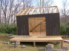 How to Build a Mortgage-free Small House for $5,900 -- article shows stages of self-built cabin with bedroom, bath, kitchenette and living area plus porch. Inspiring!