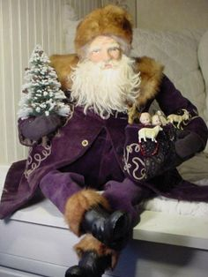 Lovely Santa dressed in a royal purple coat with fur collar & hat by Norma DeCamp