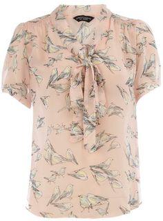 Peach bird print blouse with short sleeves. $29