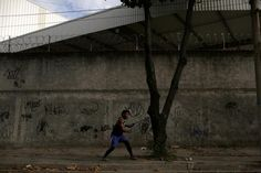 OLYMPICS-RIO/REFUGEE Popole Misenga, a refugee from the Democratic Republic of Congo and a judo athlete, trains using an elastic belt near his home in a slum in Rio de Janeiro, Brazil, June 2, 2016. REUTERS/Pilar Olivares  http://www.dralexjimenez.com/sport-specific-training/