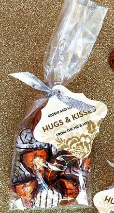 Three Budget-Friendly Wedding Favor Ideas Little paper bags with our initials and wedding date on it at the candy buffet. Hugs and Kisses Wedding Favors Wedding Favors And Gifts, Summer Wedding Favors, Personalized Wedding Favors, Wedding Reception Favors, Wedding Invitations, Rustic Wedding Favors, Decor Wedding, Wedding Themes, Cheap Bridal Shower Favors