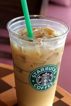 Starbucks Iced Vanilla Coffee with cream and Carmel drizzle wish i could drink one every morning noon and night!