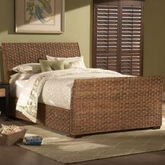 Woven abaca sleigh bed.   Product: BedConstruction Material: Woven abaca and solid hardwoodColor: Brown