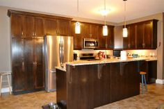 View Listing Details Beautiful yet very functional kitchen open to the great room, with natural gas services, double pantry unit, center island & granite countertops #ReMax #Halifax #Dartmouth