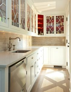 Love the Chippendale inspired cabinetry fronts in this Butler's Pantry ...and red interior?  I'm in heaven!