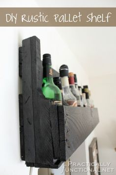 like the idea, but I think I would stain pallet rather than paint black - DIY Pallet Shelf