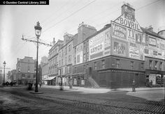 This photograph looks westwards along High Street, Dundee, showing the north side section from Melville House in the distance to Whytock the jewellers to the right. Next door to Whytock's are Lennie and Thomson, opticians and Patterson's Boot Market. Above, the familiar Shipping Agent's advertisements have gone, and in their stead are larger commercial posters.