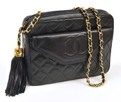 Lot No. 377  A CAMERA HANDBAG BY CHANEL Styled in quilted navy leather with monogram outer pocket, having a gold metal clasp and conforming woven chain strap with tassel detail, 23 x 17cm.  Estimate $1,200-$1,400 #vintage #handbag #chanel #luxury