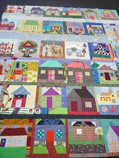 Patchwork houses by alison.klein i like the applique vine/flowers on left side