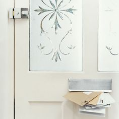 Patterned vinyl film can add a period touch—and privacy—to glass entry doors or sidelights. To apply, clean the glass, cut the film to size, spray the glass with water, and press the film into place. Use a squeegee to smooth out any air bubbles. | Photo: Digital Vision/Getty Images | thisoldhouse.com