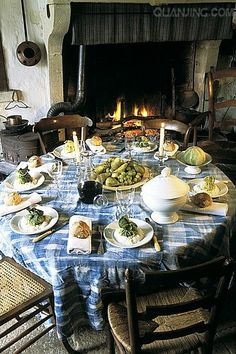 A table set in France by a warm fire